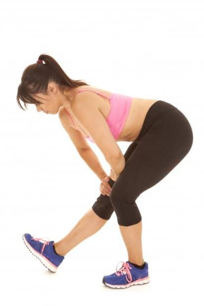 fitness woman pink sports bra stretch lean