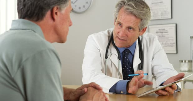 Patient talking to a doctor about their chronic condition.