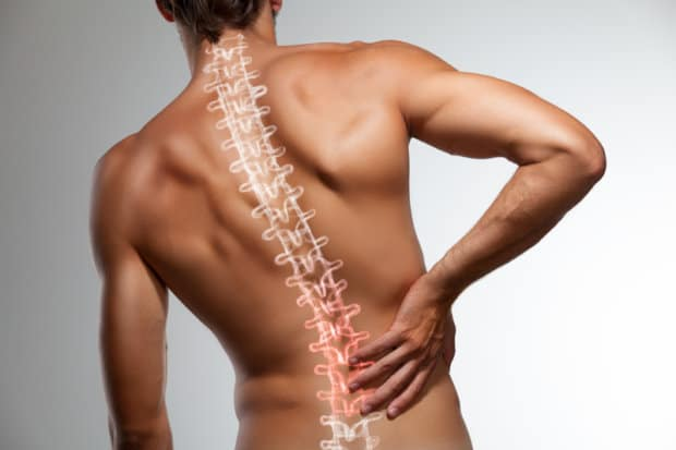 View of a man's back with his spine and back pain highlighted.
