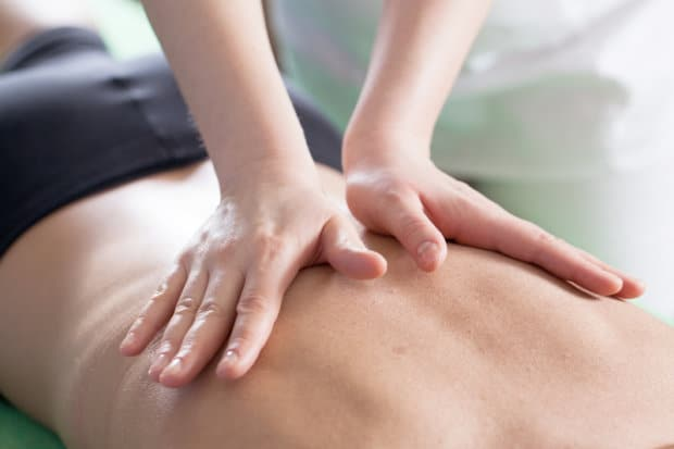 Close-up view of a person receiving a chiropractic adjustment.